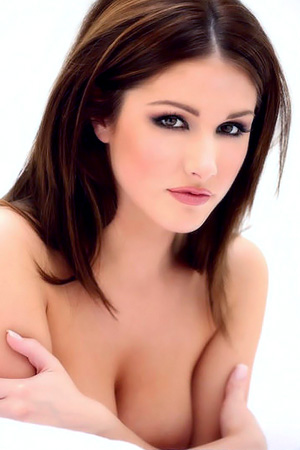 Lucy Pinder in 'Busty Brunette In Stockings' via Only-Tease